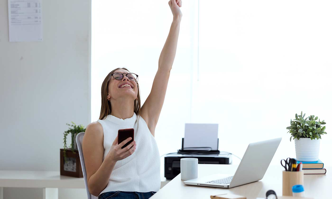 NAFS & Grimsby Creates | Woman raising arm in success