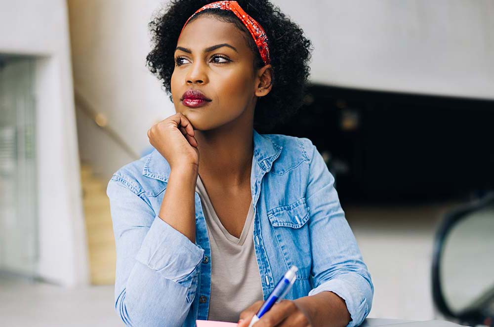 Designed Around You - Woman thinking and studying